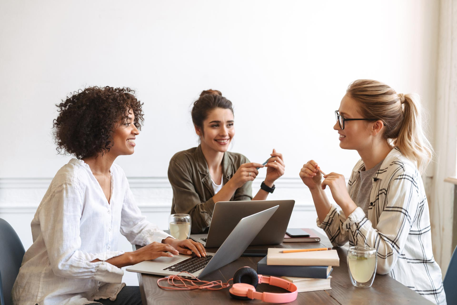 group-of-cheerful-young-women-studying-together-AHK5QF2.jpg